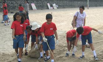 Beach clean-up drive by the MET Rishikul Vidyalaya students